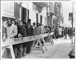 Unity Funeral Home. Crowds outside of Unity Funeral Home, where the body of Malcolm X lies in repose. The public viewing was attended by 14,000-30,000 mourners. Credit: O. Fernandez/Library of Congress