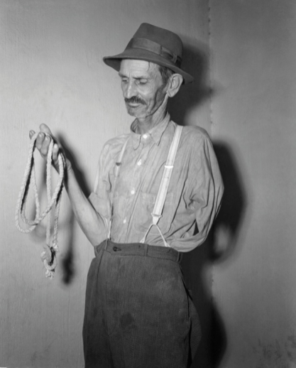 Coroner WT Brown holds a piece of rope used in the lynching. Photograph: Bettmann/Corbis