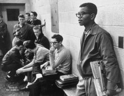 """Lewis Cousins, age 15, Standing Tall Amid the Glares by Paul Schutzer Lewis Cousins, age 15, the only African American student in the newly desegregated Maury High School, standing alone. 1959, Norfolk, VA. Cousins was the only black student to attend Maury High School in 1959 at 15 years old. He graduated in 1962. The other members of the Norfolk 17 referred to Louis as """"the professor"""" because of his intelligence. As witnessed in a much-publicized photograph*, he too was ostracized."""