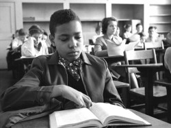 """In the classroom: James """"Skip"""" Turner Jr. sits in class at Norview Junior High School. White students sat in the rear of the classroom, leaving several empty chairs to separate them from the African American students. (Virginian-Pilot file photo)"""