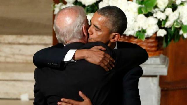 President Barack Obama kisses Vice President Joe Biden during funeral services for Biden's son, Beau Biden, Saturday, June 6, 2015, at St. Anthony of Padua Church in Wilmington, Del. Obama delivered the eulogy for Vice President Joe Biden's son, Beau, who lost his battle with brain cancer at age 46. (Yuri Gripas/Pool Photo via AP)
