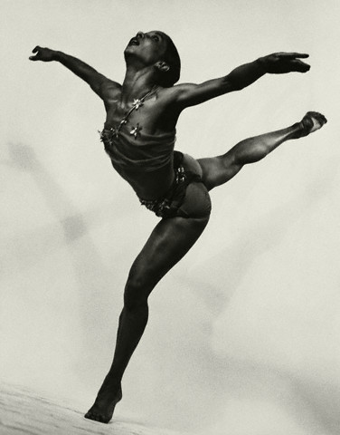 ca. 1950 --- Janet Collins, dancer, in arabesque from a production of Cole Porter's musical . --- Image by © Condé Nast Archive/CORBIS