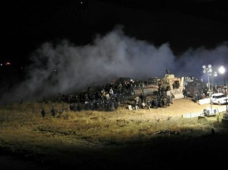 The sheriff's office said the incident began around 6 p.m. when protesters removed a burned-out truck that had been on the bridge since the October 27 confrontation Read more: http://www.dailymail.co.uk/news/article-3955878/Police-protesters-face-Dakota-Access-pipeline.html#ixzz4QdLLyAiq Follow us: @MailOnline on Twitter | DailyMail on Facebook