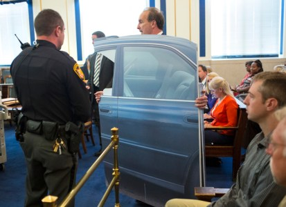 A Cincinnati Police Detective brings in life size cardboard cutout of the car Sam DuBose was driving when he was shot and killed by Ray Tensing, former University of Cincinnati police officer, July 19, 2015. The car was a 1998 Honda Accord. Tensing is on trial for murder. The presiding judge is Common Pleas Judge Megan Shanahan. Tensing's lawyer, Stan Mathews has said Tensing fired a single shot because he feared for his life. The Enquirer/ Carrie Cochran
