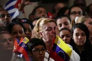 A woman reacts during a homage ceremony of the late former Cuban leader Fidel Castro at the 4F military fort in Caracas