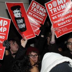 Protesters stand up for the rights of immigrants during a rally outside the Brooklyn Federal Courthouse against President Trump's travel ban on selected Muslim countries. ACLU lawyers later won a temporary stay on deportations and detentions from U.S. District Judge Ann Donnelly.