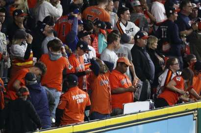 Fans react after a Houston Astros out during the ninth inning as the Houston Astros lose to the Los Angeles Dodgers 6-2 in Game 4 of the World Series at Minute Maid Park Saturday, Oct. 28, 2017 in Houston.