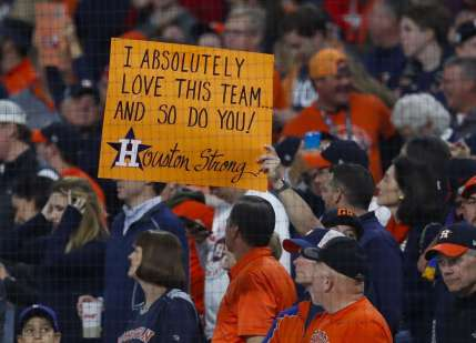 Astros fans hold a sign during Game 4 of the World Series at Minute Maid Park on Saturday, Oct. 28, 2017, in Houston.