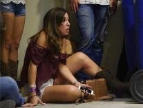 Powers Imagery/Powers Imagery/Invision/APA woman hides inside the Sands Corporation plane hangar after a mass shooting in which dozens were killed at the Route 91 Harvest Festival on Sunday, Oct. 1, 2017, in Las Vegas. (Al Powers/Invision/AP)