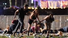 People run from gunfire at the Route 91 Harvest country music festival in Las Vegas. CREDIT: David Becker / Getty Images