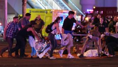 An injured person is tended to in the intersection of Tropicana Ave. and Las Vegas Boulevard after a mass shooting at a country music festival Ethan Miller/Getty