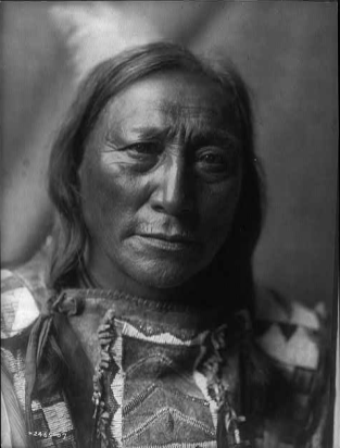 Native American man from the Atsina Tribe named Hollow Horn Bear. Photograph by Edward S Curtis