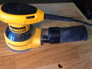 DeWalt sander with included dust catcher accessory