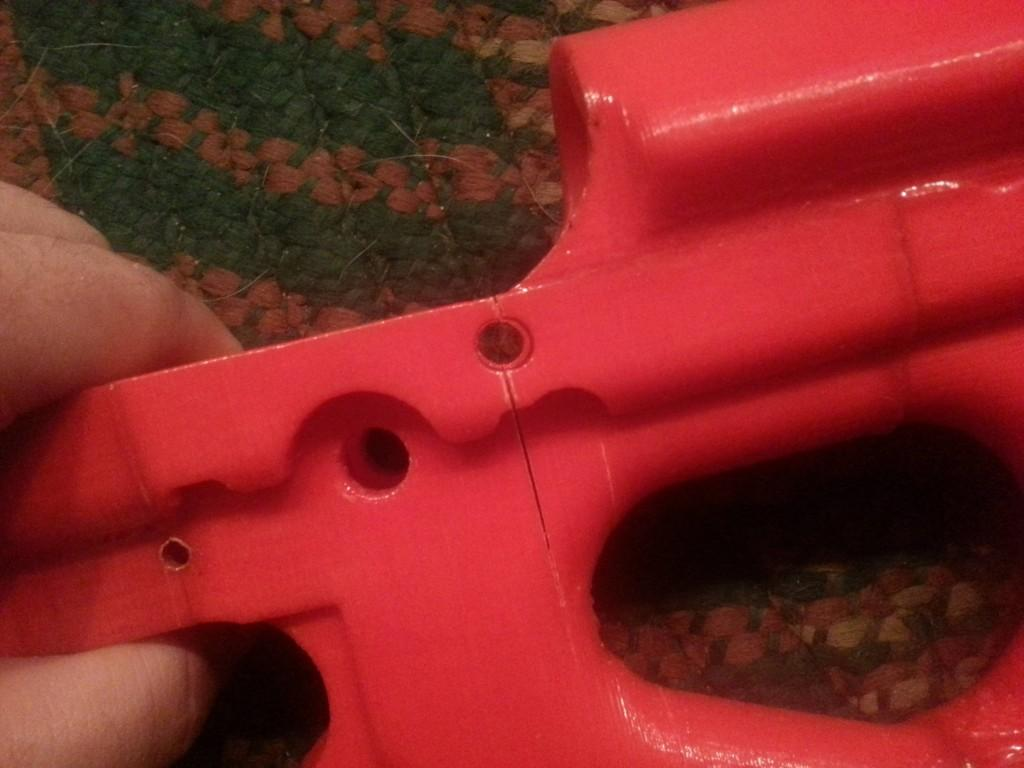 after six shots it split vertically through the rear takedown pin as shown here