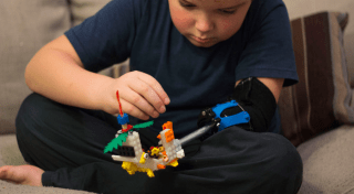"""Aidan playing with his """"lego arm"""""""