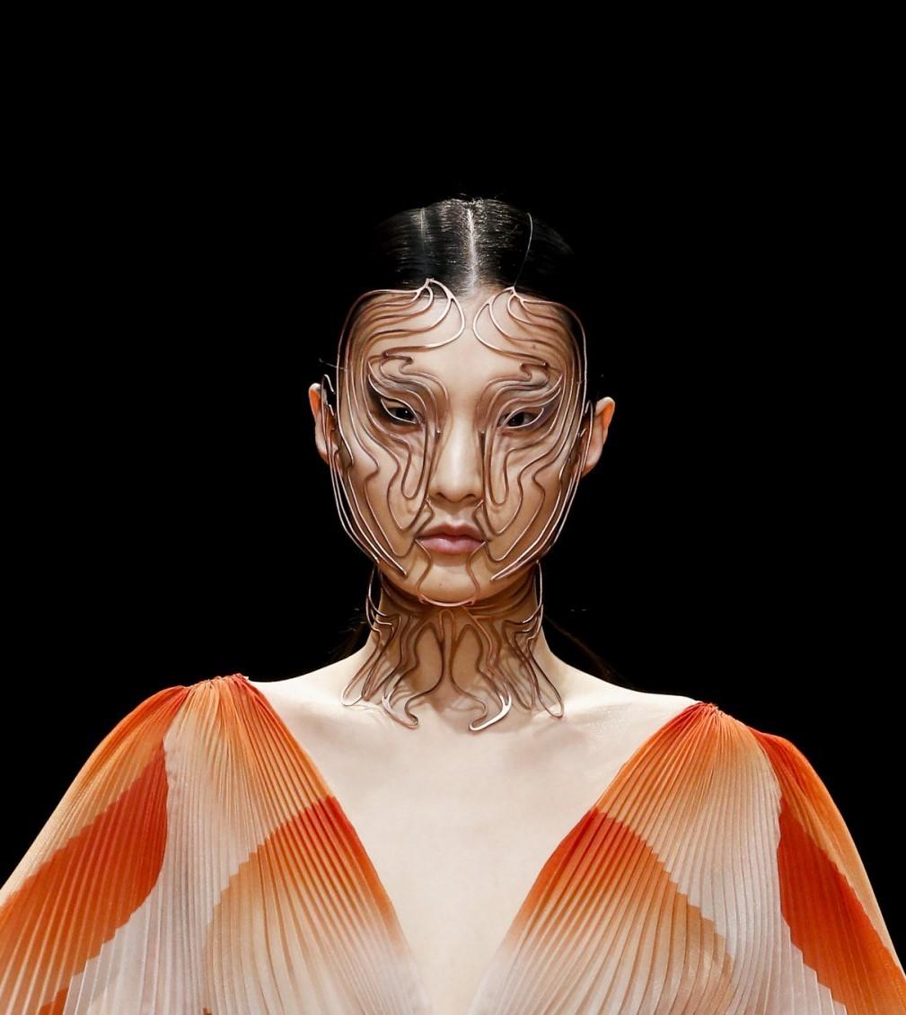 "Close up of model wearing ""Cellchemy"" facemask. Photo via Iris van Herpen."