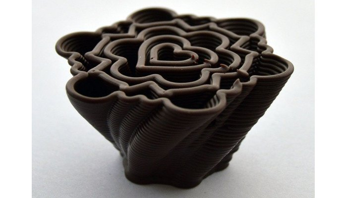 3d printed chocolate print of a heart inside a snowflake