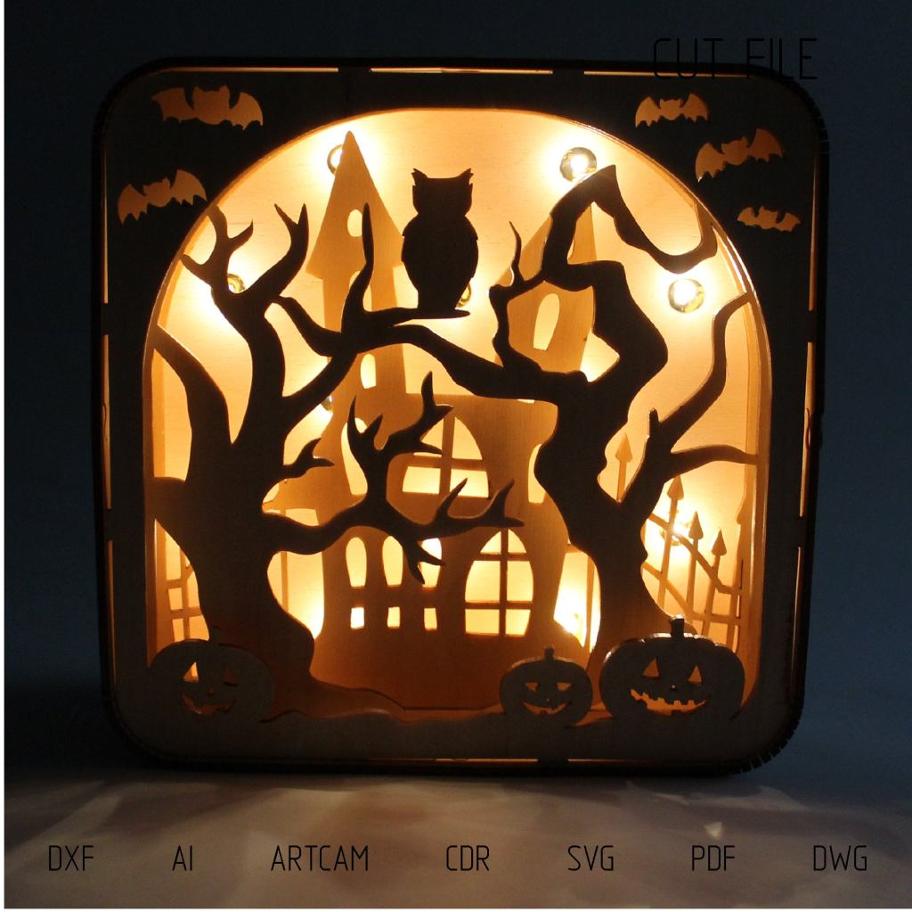 Halloween themed laser cut light box with spooky house and owl
