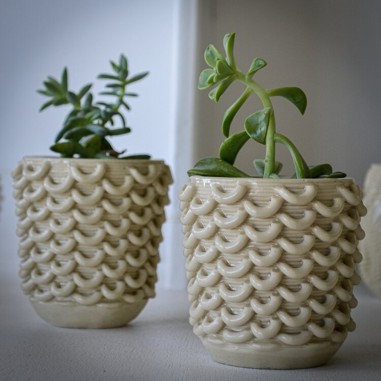 Small 3D printed ceramic flower pots created with the 3D Potter 3D printers
