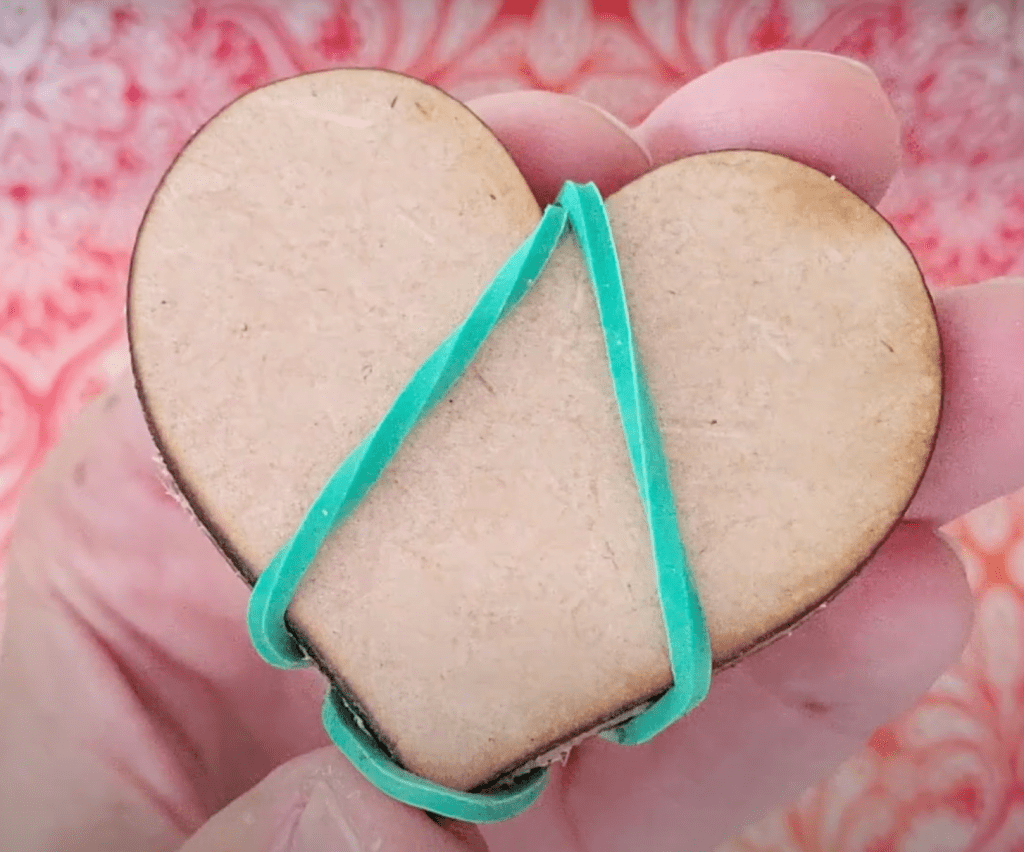 heart shapes rubber banded together to help dry glue