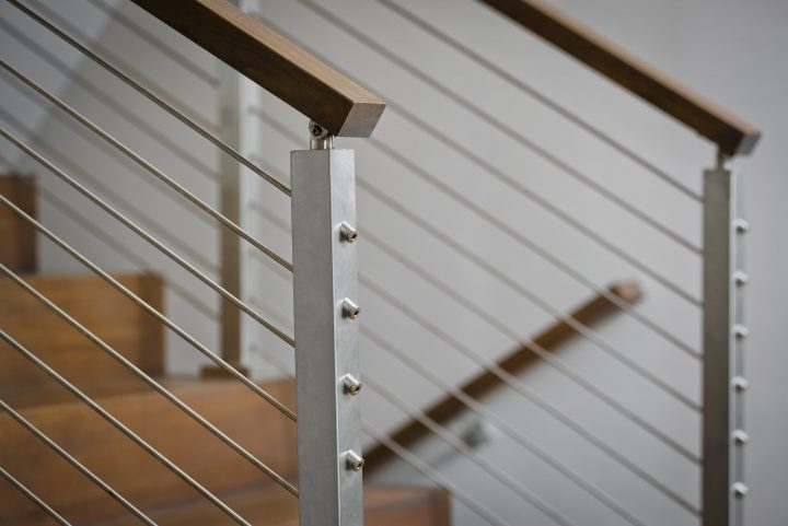 Cable Railing Vs Wood Railing Owings Brothers Contracting | Cable Stair Railing Indoor | Exterior Irregular Stair | Vertical | Wood | 90 Degree Stair | Stainless