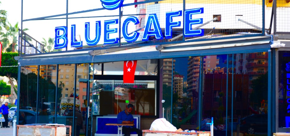 Neon Signs on front of Blue Cafe mahmutlar - we love mahmutlar