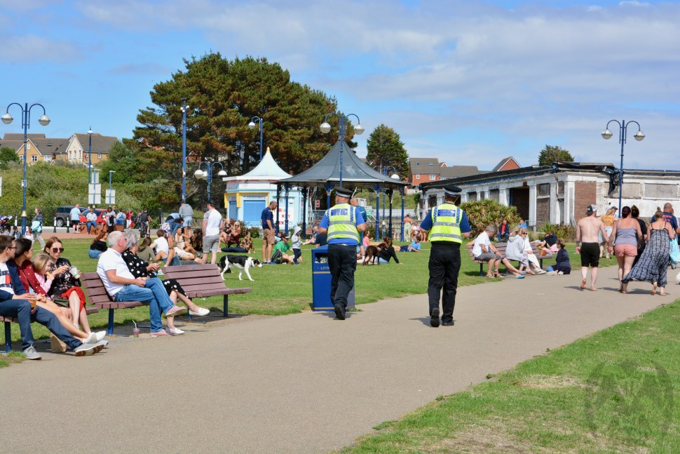 BARRY ISLAND IS OPEN AGAIN AFTER WEEKS OF LOCKDOWN AND RESIDENTS ENJOY A GLASS OF BEER ON THE GRASS