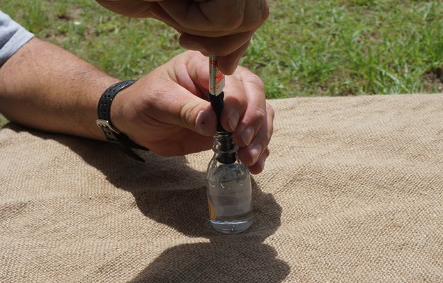 Insert Your DIY Wick in the Bottle   How To Make An Improvised Camping Lantern