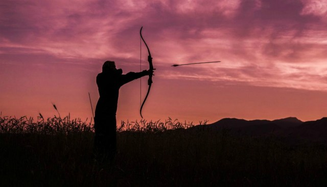 Archer in the sunset | Alaska Hunting Laws and Regulations