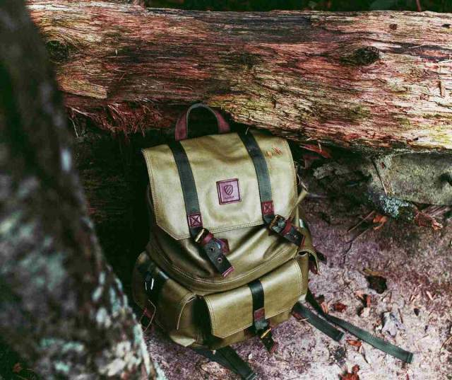 Green bag in the woods | The Ultimate Bug Out Bag List For Every Survivalist