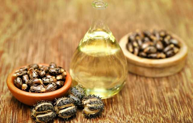 Castor beans and oil in a glass jar | Ways To Remove A Splinter