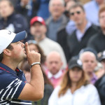 Patrick Reed hushes the crowd at Gleneagles in 2014. (AP Photo/Peter Morrison)