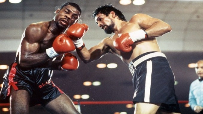 Roberto Duran punches Iran Barkley in their WBC Middleweight title bout on February 24, 1989