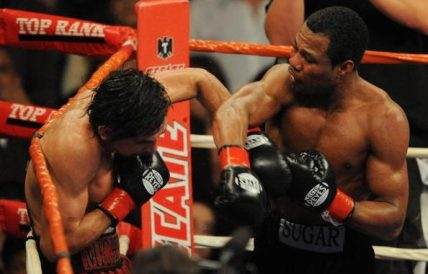 Shane Mosley has Antonio Margarito against the ropes