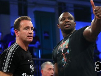 Dillian Whyte gives a thumbs up with trainer Mark Tibbs