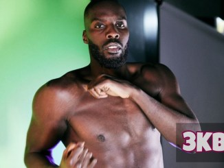 Lawrence Okolie throws left hook to the body