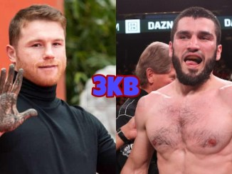 "Saul ""Canelo"" Alvarez holds up a muddy hand, Artur Beterbiev in the ring following a victory"