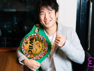 Kenshiro Teraji smiles holding his WBC World Light Flyweight title