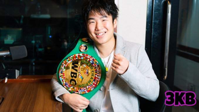 Kenshiro Teraji smiles holding his WBC World Light Flyweight title
