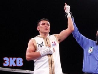Tursynbay Kulakhmet's hand raised after victory.