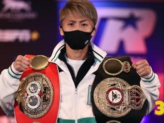 Naoya Inoue with the IBF and WBA titles.