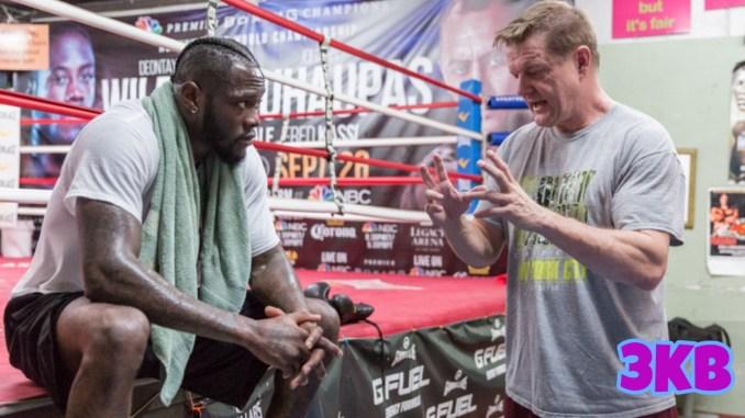 Former world champion Deontay Wilder listening to coach Jay Deas