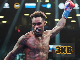 Jermall Charlo taunts his opponent with his arm raised.