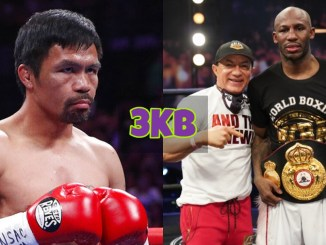 Manny Pacquiao looks towards Yordenis Ugas with the WBA belt around his waist.