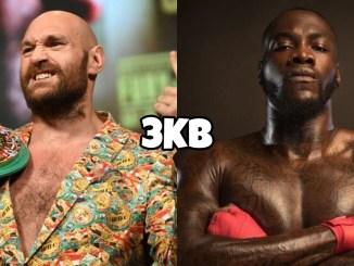 WBC champion Tyson Fury poses at the press conference, Deontay Wilder with his arms crossed
