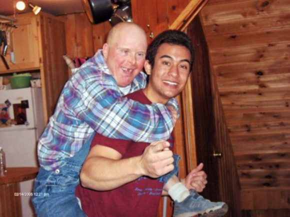 Valentine's Day on the farm. Mike gives a piggyback ride to a resident named Denis. (Fabiola Carletti)