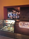 The bistro. You can see the desert display and the open kitchen in the background.