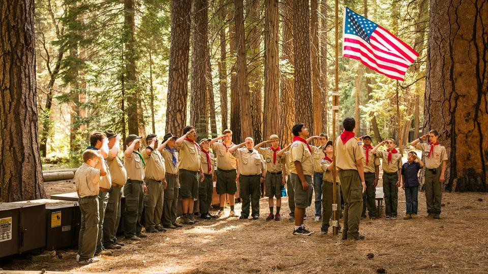 Scouts saluting a flag