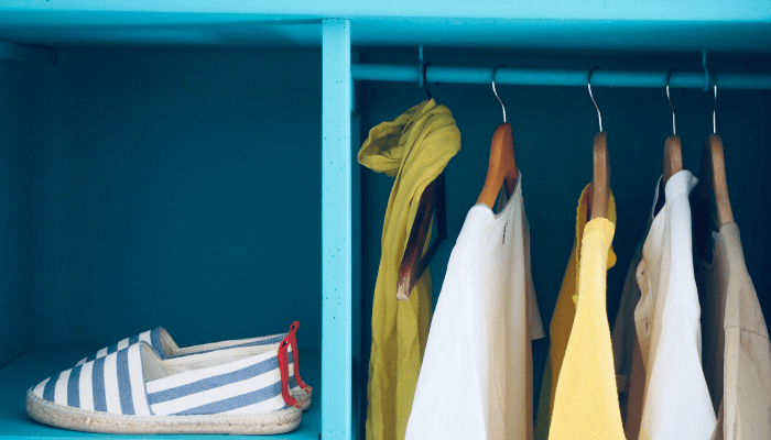 A closet in a home that is being staged.