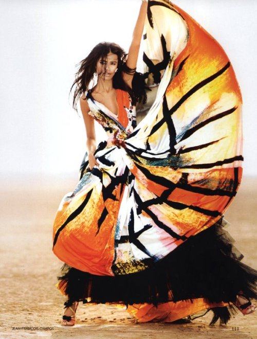 """Saffron Days"" Vogue India, May 2009photographer: Jean-Francois Campos Lakshmi Menon black, orange, white, yellow print dress Smile: Vogue India May 2009: Lakshmi Menon"